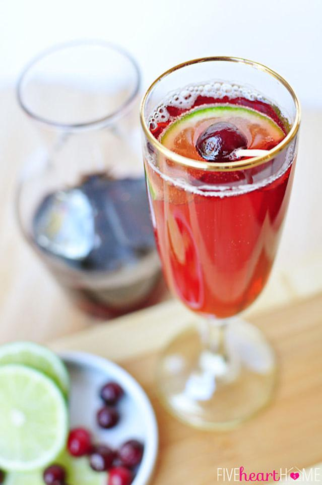 "<p>Start with a base of cranberry and pomegranate juice, then top with seltzer water and a squeeze of fresh lime juice. </p><p><strong>Get the recipe at <a rel=""nofollow"" href=""http://www.fivehearthome.com/2013/12/22/cranberry-pomegranate-bellinis-with-lime/"">Five Heart Home</a>.</strong> </p>"
