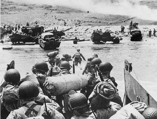 <p>American soldiers and supplies arrive on the shore of the French coast of German-occupied Normandy during the Allied D-Day invasion on June 6, 1944, in World War II. (Photo: AP) </p>