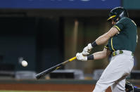 Oakland Athletics' Matt Chapman connects for an RBI single during the seventh inning of a baseball game against the Texas Rangers, Wednesday, June 23, 2021, in Arlington, Texas. (AP Photo/Brandon Wade)