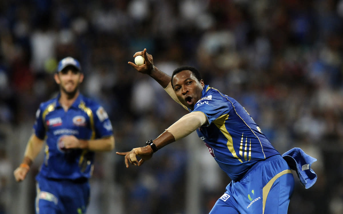 Kieron Pollard of Mumbai Indians celebrates after completing a catch to get Shane Watson of Rajasthan Royals out during match 66 of the Pepsi Indian Premier League ( IPL) 2013  between The Mumbai Indians and the Rajasthan Royals held at the Wankhede Stadium in Mumbai on the 15th May 2013 ..Photo by Pal Pillai-IPL-SPORTZPICS ..Use of this image is subject to the terms and conditions as outlined by the BCCI. These terms can be found by following this link:..https://ec.yimg.com/ec?url=http%3a%2f%2fwww.sportzpics.co.za%2fimage%2fI0000SoRagM2cIEc&t=1506366598&sig=fp83JUB6HYsU0V7BCxbImw--~D