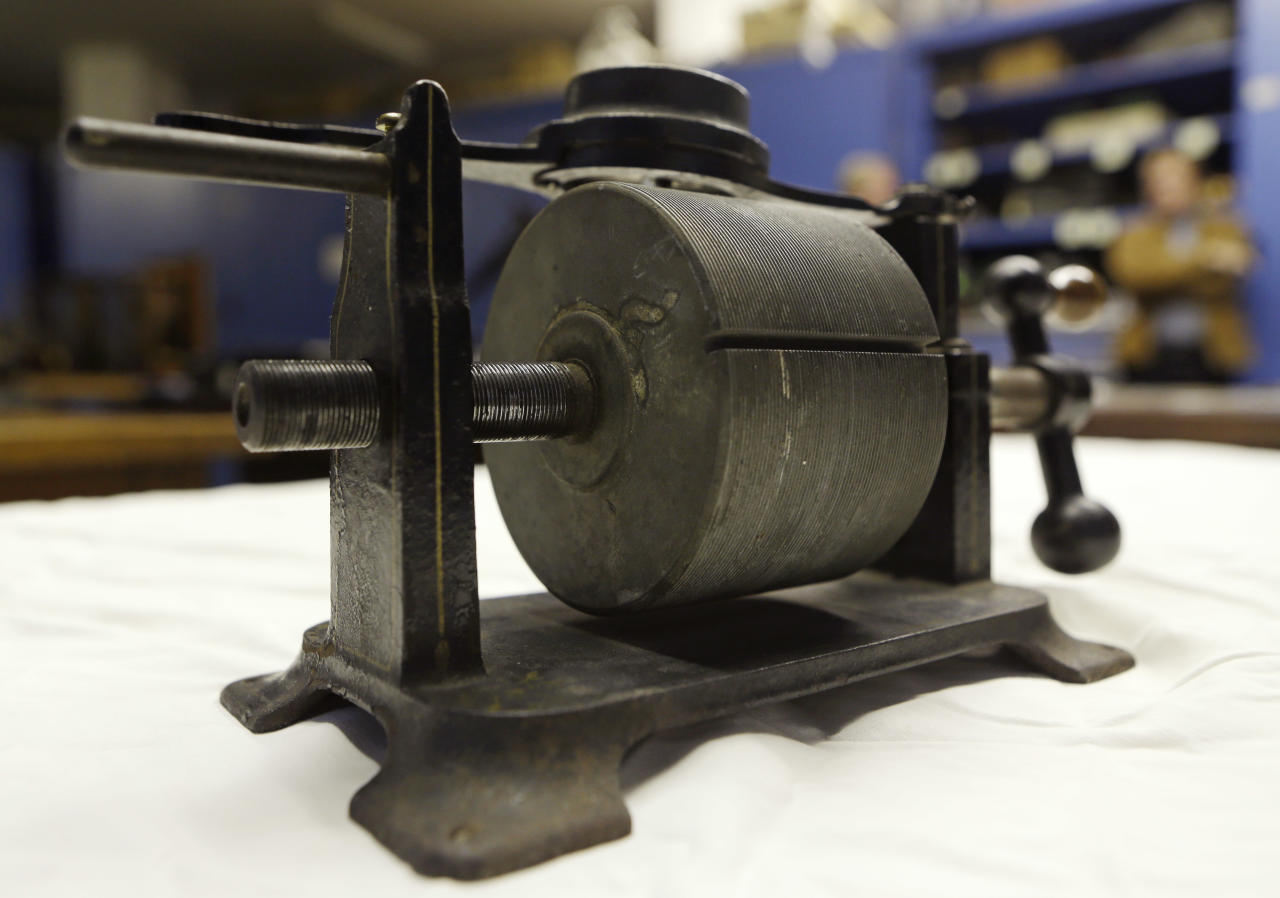 An 1879 tinfoil phonograph is displayed at the Museum of Innovation and Science, on Wednesday, Oct. 24, 2012, in Schenectady, N.Y. Researchers have digitized what experts say is the oldest recording of a playable American voice and history's first-ever recorded musical performance, along with the first recorded blooper. Recorded on a sheet of tinfoil on a phonograph invented by Thomas Edison, the recording was made in St. Louis in 1878. It contains a short coronet solo of an unidentified song, followed by the voices of a man reciting popular nursery rhymes. (AP Photo/Mike Groll)