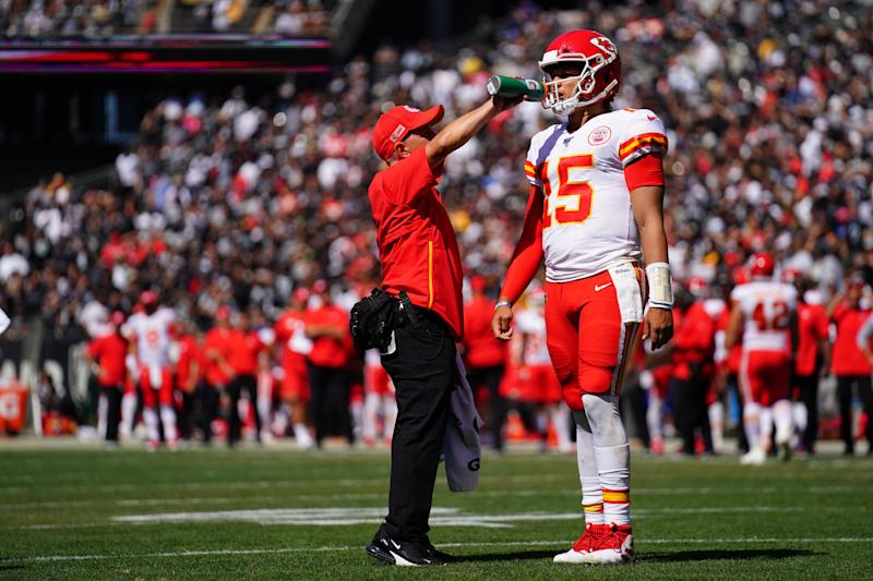 OAKLAND, CALIFORNIA - SEPTEMBER 15: Patrick Mahomes #15 of the Kansas City Chiefs is given a drink of water during the game against the Oakland Raiders at RingCentral Coliseum on September 15, 2019 in Oakland, California. (Photo by Daniel Shirey/Getty Images)