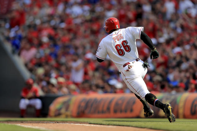 Cincinnati Reds' Yasiel Puig runs the bases as he hits a two-run RBI single in the third inning of a baseball game against the Los Angeles Dodgers, Saturday, May 18, 2019, in Cincinnati. (AP Photo/Aaron Doster)