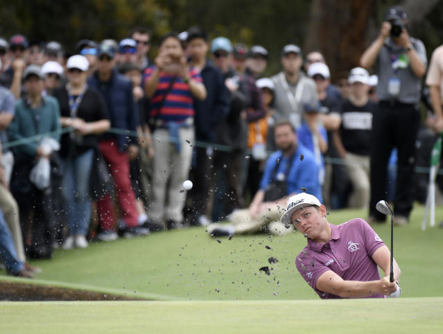 Australia's Cameron Smith hits out of a bunker during the World Cup of Golf in Melbourne, Australia, Sunday, Nov. 25, 2018. (AP Photo/Andy Brownbill)