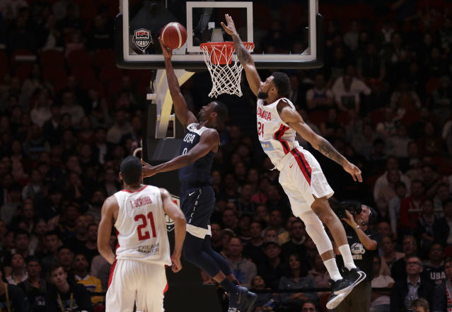 Canada's Khem Birch, right, attempts to defend a layup by United States' Harrison Barnes during their exhibition basketball game in Sydney, Australia, Monday, Aug. 26, 2019. (AP Photo/Rick Rycroft)