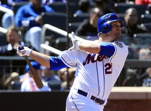 New York Mets' Lucas Duda follows though on a home run during the fourth inning of a baseball game against the Atlanta Braves Saturday, April 7, 2012, in New York. (AP Photo/Frank Franklin II)