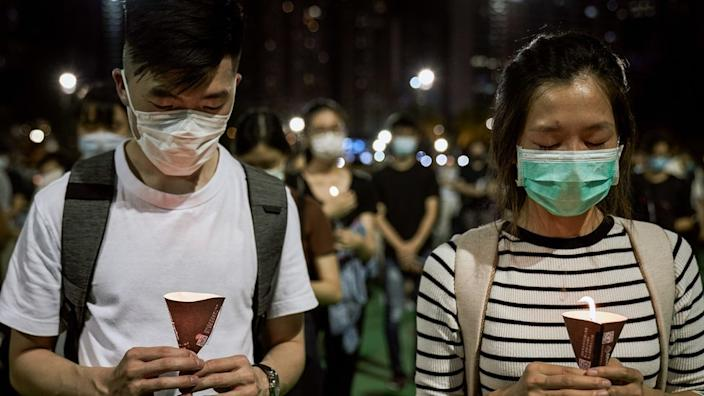 People hold their candles during the 31st Anniversary of the Tiananmen Massacre.