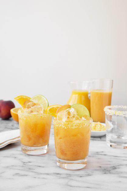 <p><strong>Ingredients:</strong></p><p>.5 teaspoon grated orange zest<br>.25 cup kosher salt<br>2 tablespoons sugar<br>3 tablespoons fresh lime juice<br>2 cups fresh orange juice<br>1 ripe peach, pitted and coarsely chopped<br>8 ounces silver tequila<br>Club soda</p><p><strong>Instructions: </strong><br> <br>In a small bowl, combine the orange zest, salt, and sugar. Using your fingers, work the zest into the salt and sugar until the mixture is fragrant. Rim four glasses with salt mixture and set aside. </p><p>In a blender, combine the lime juice, the orange juice, and the peach chunks and blend. Strain through a fine-mesh strainer. Fill each of the prepared glasses with ice. Pour 2 ounces of tequila into each glass. Top with .5 cup of the juice mixture. Top with club soda, and stir. Garnish with fruit slices, and serve.</p><p><em>From </em>Over Easy<em> by Joy Wilson; published by Clarkson Potter.</em></p>