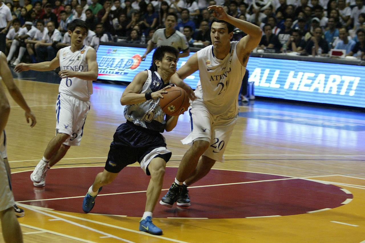 Lester Alvarez of Adamson goes for the basket against Greg Slaughter of Ateneo during the UAAP Season 74 basketball game held at Smart Araneta Coliseum, Quezon City. (Marlo Cueto/NPPA Images)