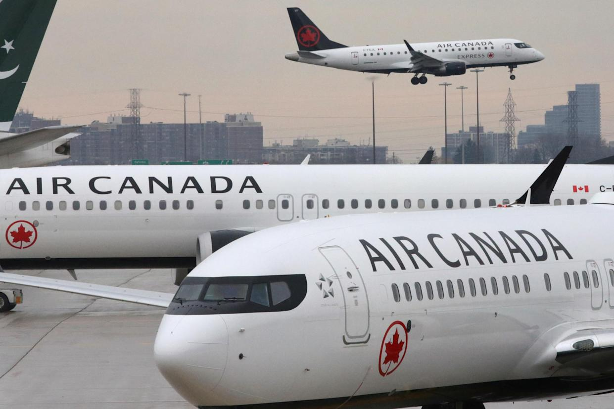 Two Air Canada Boeing 737 MAX 8 aircraft are seen on the ground on March 13, 2019 at Toronto Pearson International Airport in Toronto, Ontario, Canada. (REUTERS / Chris Helgren)