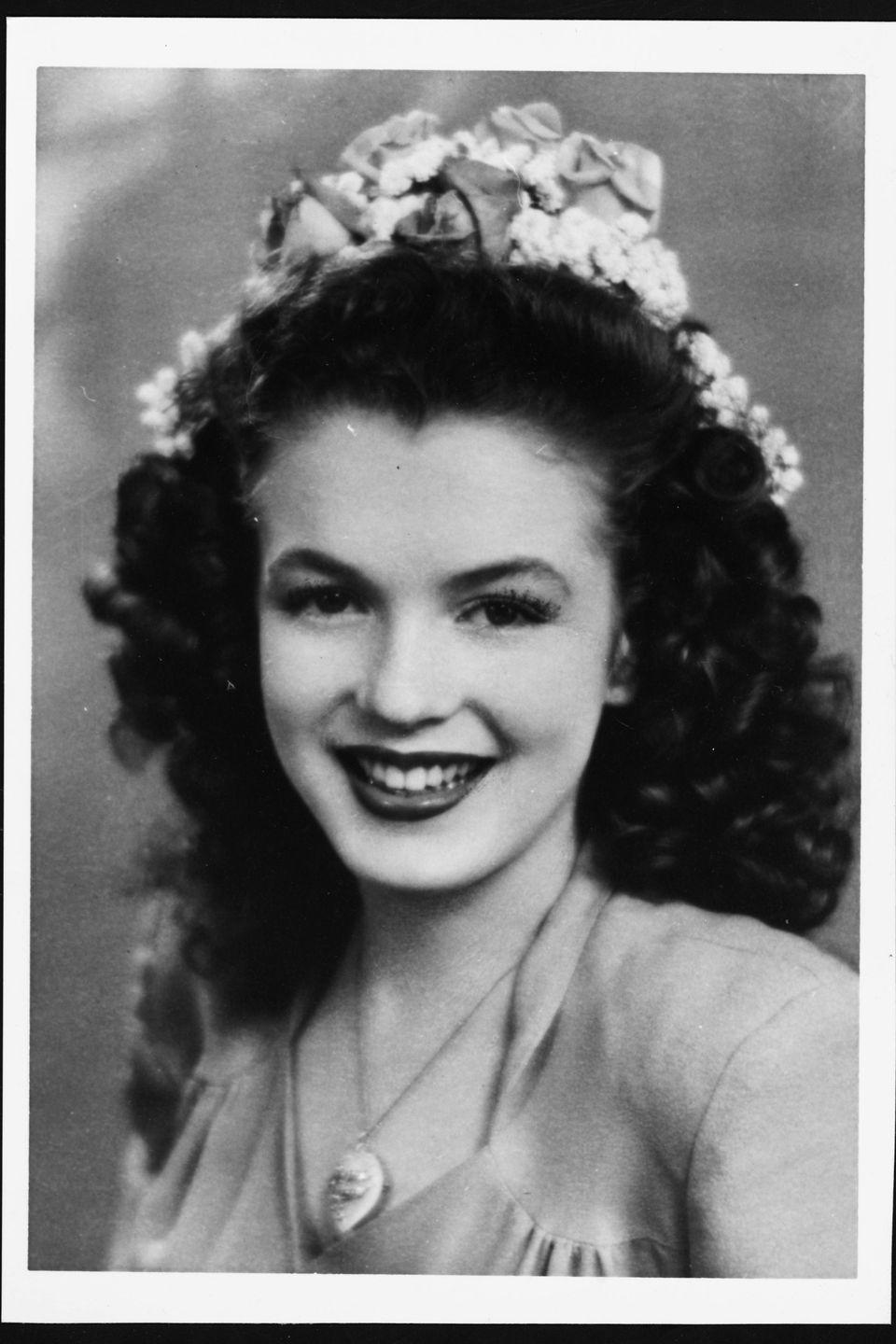 <p>A teenage Norma Jeane with brunette hair at 15 years old. </p>