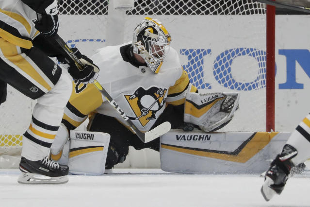 Pittsburgh Penguins goaltender Matt Murray blocks a shot during the first period of the team's NHL hockey game against the Anaheim Ducks in Anaheim, Calif., Friday, Jan. 11, 2019. (AP Photo/Chris Carlson)