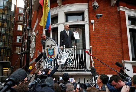 FILE PHOTO: WikiLeaks founder Julian Assange holds a copy of a U.N. ruling as he makes a speech from the balcony of the Ecuadorian Embassy, in central London, Britain February 5, 2016. REUTERS/Peter Nicholls/File Photo