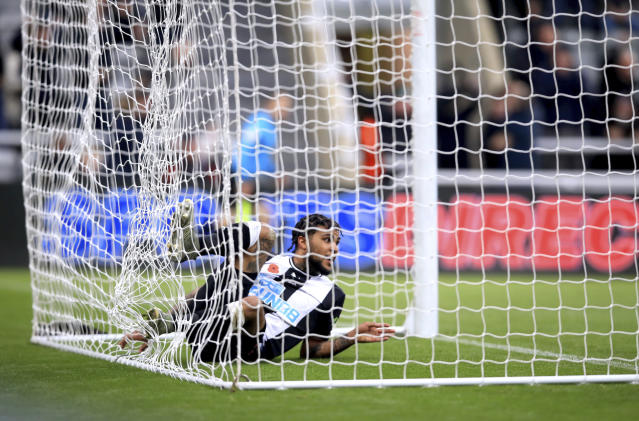 Newcastle United's DeAndre Yedlin scores his side's first goal of the game, during the English Premier League soccer match between Newcastle and Bournemouth, at St James' Park, in Newcastle, England, Saturday Nov. 9, 2019. (Owen Humphreys/PA via AP)