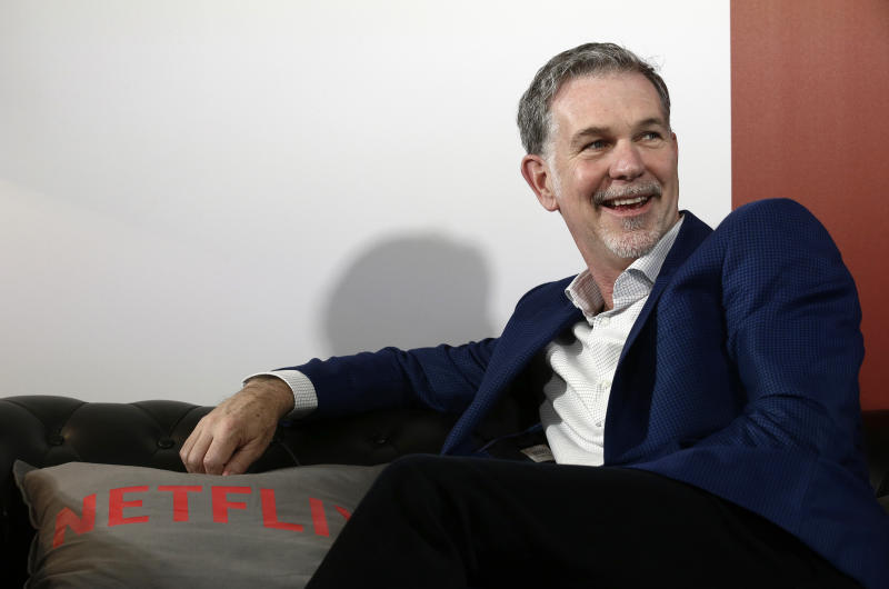 Founder and CEO of Netflix Reed Hastings smiles during an interview with The Associated Press in Barcelona, Spain, Tuesday, Feb. 28, 2017. Netflix employees were personally affected by U.S. President Donald Trump's attempt to ban people entering from seven Muslim countries, its CEO said Tuesday. (AP Photo/Manu Fernandez)