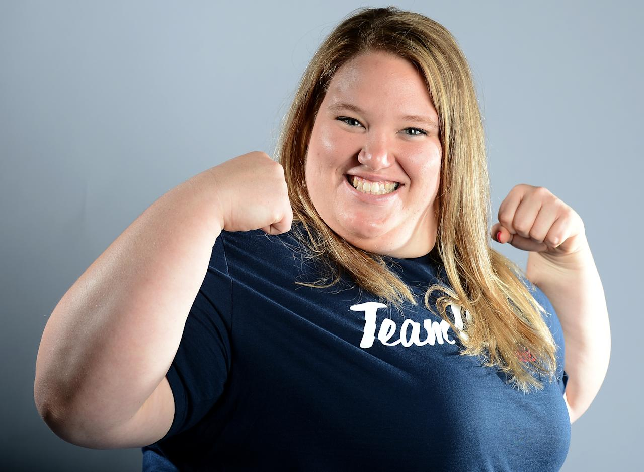 Holley Mangold of the US Olympic Weightlifting team poses for pictures during a photo session during the 2012 Team USA Media Summit on May 13, 2012 in Dallas,Texas.   AFP PHOTO/JOE KLAMARJOE KLAMAR/AFP/GettyImages