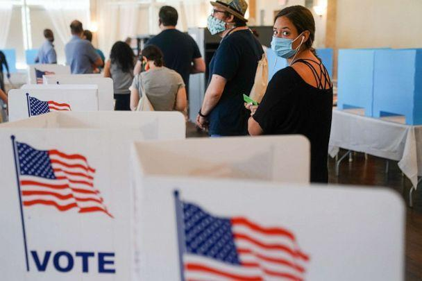 PHOTO: People wait in line to vote in Georgia's primary election, June 9, 2020 in Atlanta. Voters in Georgia, West Virginia, South Carolina, North Dakota, and Nevada are holding primaries amid the coronavirus pandemic. (Elijah Nouvelage/Getty Images)