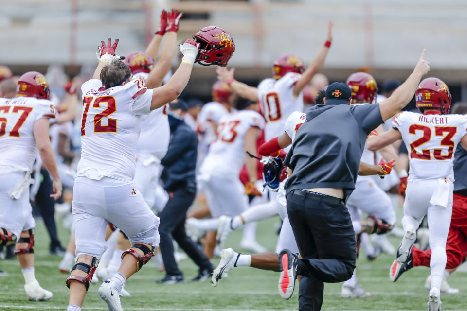 Iowa State Cyclones players and coaches run onto the field after the tying field goal was missed by the Texas Longhorns. (Photo by Matthew Pearce/Icon Sportswire via Getty Images)