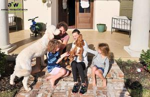 The family has their new puppy delivered directly to their door by ATW