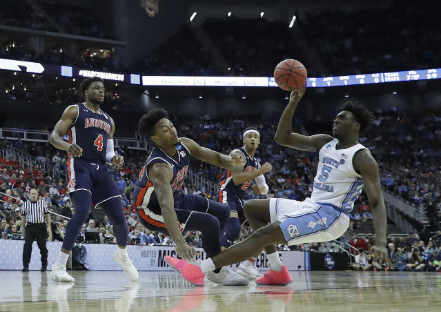 <p>North Carolina's Nassir Little (5) tries to get off a shot as Auburn's Malik Dunbar (4), Anfernee McLemore and Bryce Brown (2) defend during the first half of a men's NCAA tournament college basketball Midwest Regional semifinal game Friday, March 29, 2019, in Kansas City, Mo. (AP Photo/Charlie Riedel) </p>
