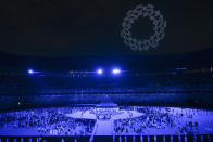 <p>TOKYO, JAPAN - JULY 23: A drone display is seen over the top of the stadium during the Opening Ceremony of the Tokyo 2020 Olympic Games at Olympic Stadium on July 23, 2021 in Tokyo, Japan. (Photo by Dylan Martinez - Pool/Getty Images)</p>