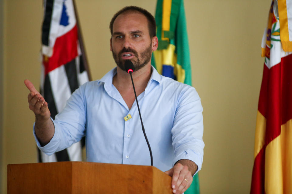 ELDORADO, BRAZIL - SEPTEMBER 03: Eduardo Bolsonaro, Federal Deputy speaks during the presentation of a bridge development project over the Ribeira de Iguape river on September 3, 2020 in Eldorado, Brazil. Eldorado is a city in the countryside of the state of Sao Paulo where Jair Bolsonaro was raised. The bridge will provide access from the Boa Esperanca neighborhood to the Quilombo de Sao Pedro. (Photo by Miguel Schincariol/Getty Images)