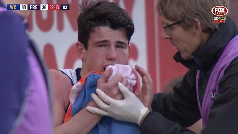 A screenshot of Fremantle's Andrew Brayshaw after being punched by West Coast's Andrew Gaff