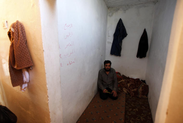 In this photo taken Thursday, June 14, 2012, a Syrian army officer sits in a small room while he is detained by the Free Syrian Army in the Jabal Al- Zawiya area near Idlib, Syria. During two weeks with rebels in northern Syria, three Associated Press journalists found more than 20 rebel groups who often destroy government army posts and convoys but lack the weapons and unity to do more than gradually chip away at the regime of President Bashar Assad _ a recipe for a long, bloody insurgency.(AP Photo/ Khalil Hamra)