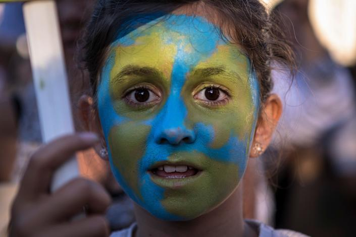 A young girl taking part in the climate strike in Madrid, Spain – one of the many climate strikes that took place all around the world in September 2019.  (Photo: Guillermo Guterrez Carrascal/SOPA Images/LightRocket via Getty Images)
