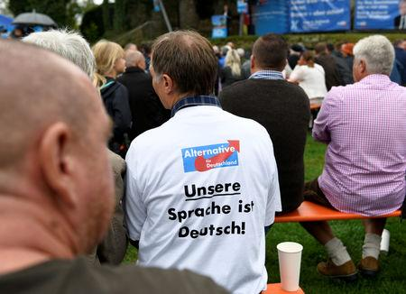 FILE PHOTO: A supporter of Germany's anti-immigration party Alternative for Germany (AfD) wearing a t-shirt that reads 'Our language is German' attends the traditional Gillamoos festival in Abensberg, Germany, September 3, 2018. REUTERS/Andreas Gebert/File Photo