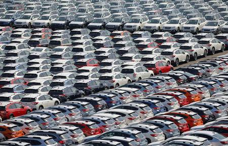 FILE PHOTO : Newly manufactured cars of the automobile maker Subaru await export in a port in Yokohama