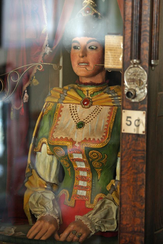 This July 28, 2011, photo shows an antique Gypsy fortune teller machine, in Virginia City, Mont., that has received multimillion dollar offers from curators including magician David Copperfield. Collectors say the 100-year-old machine that speaks your fortune may be the last of its kind. (AP Photo/Michael Albans)