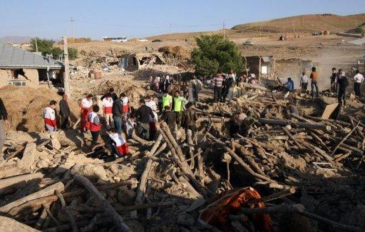 Iranian residents and rescue workers search for survivors near the town of Varzaqan