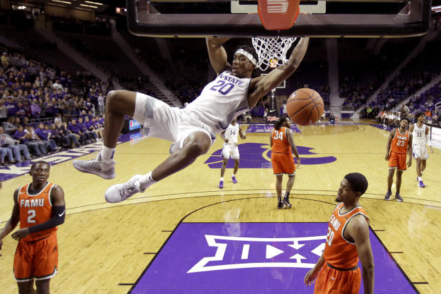Kansas State's Xavier Sneed (20) dunks during the second half of an NCAA college basketball game against Florida A&M, Monday, Dec. 2, 2019, in Manhattan, Kan. (AP Photo/Charlie Riedel)