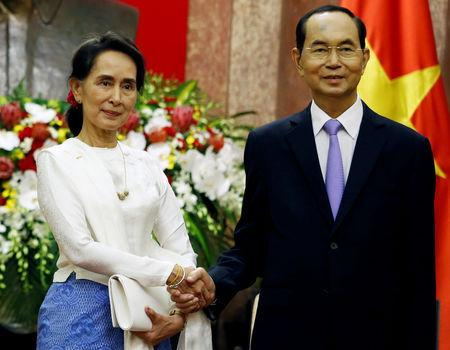 Myanmar's State Counsellor Aung San Suu Kyi (L) meets Vietnam's President Tran Dai Quang at the Presidential Palace during the World Economic Forum on ASEAN in Hanoi, Vietnam September 13, 2018. REUTERS/Kham/Pool