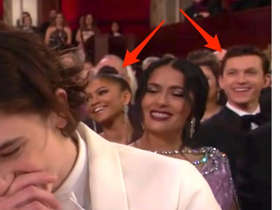 Arrows pointed at Zendaya and Tom Holland sitting together at the 2018 Oscars.