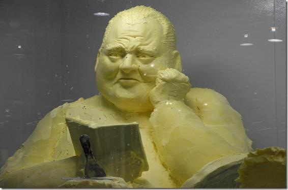 "Using nearly 230-kilograms of butter, Olenka Kleban built her sculpture of Toronto Mayor Rob Ford as part of a ""CNE tradition that involves a group of artists spending several days  inside a box chilled to about 8 degrees Celsius, sculpting creations  according to an agreed-upon theme,"" reports the <a target=""_blank"" href=""http://www.thestar.com/news/gta/article/1246373--cne-masterpiece-a-well-buttered-ford-reading-atwood-leaning-on-a-steering-wheel"">Toronto Star</a>. The butter sculpture became an instant hit as it features Toronto's controversial mayor reading a Margaret Atwood book while leaning against a steering wheel."