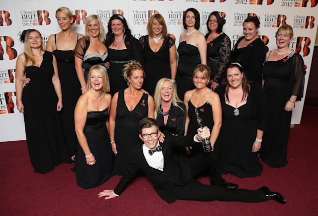 Gareth Malone and the Military Wives Choir with their Single of the Year trophy at the Classic BRIT Awards at the Royal Albert Hall on October 2, 2012. (Chris Jackson/Getty Images)