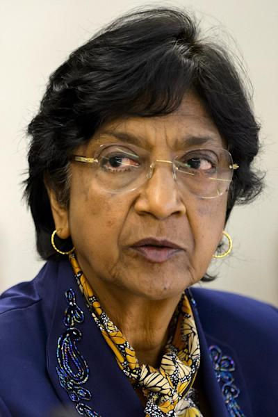 United Rights High Commissioner for Human Rights Navi Pillay looks on during an emergency session of the UN Human Rights Council in Geneva, on July 23, 2014 (AFP Photo/Fabrice Coffrini)