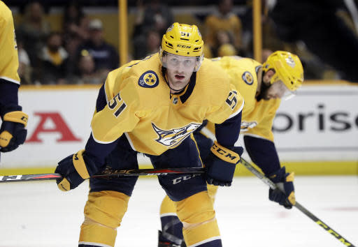 "<a class=""link rapid-noclick-resp"" href=""/nhl/teams/nas"" data-ylk=""slk:Nashville Predators"">Nashville Predators</a> left wing <a class=""link rapid-noclick-resp"" href=""/nhl/players/4978/"" data-ylk=""slk:Austin Watson"">Austin Watson</a> was suspended by the NHL for a domestic violence incident. If it stands he would be ineligible until Dec. 3. (AP Photo/Mark Humphrey)"
