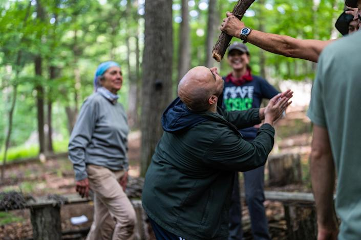 Shane Hobel demonstrates a technique for finding water in the forests of the northeastern United States. (Michael Rubenstein / for NBC News)