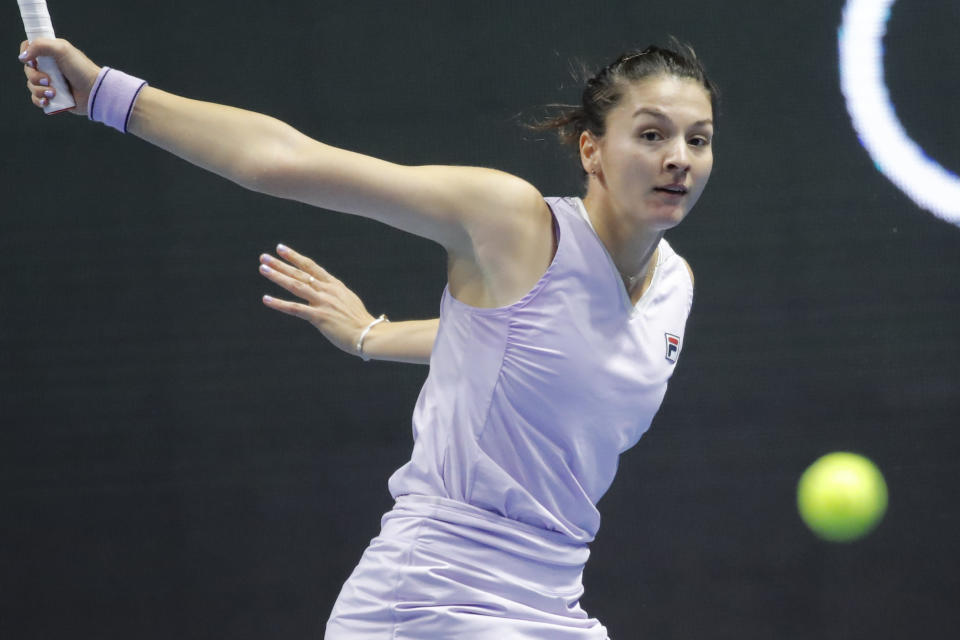 Margarita Gasparyan of Russia returns the ball to Daria Kasatkina of Russia during the St. Petersburg Ladies Trophy 2021 tennis tournament final match in St.Petersburg, Russia, Sunday, March 21, 2021. (AP Photo/Dmitri Lovetsky)