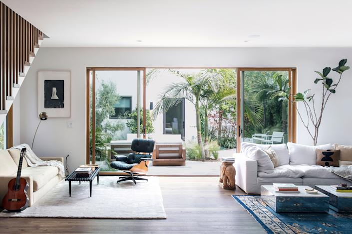 Noah Mills's living room opens up to the pièce de résistance of the home: the backyard.