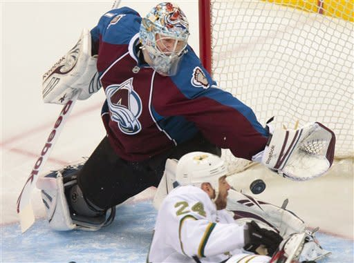 Colorado Avalanche goalie Semyon Varlamov (1), of Russia, makes a save on a shot by Dallas Stars' Eric Nystrom (24) during the first period of an NHL hockey game on Wednesday, March 20, 2013, in Denver. (AP Photo/Barry Gutierrez)