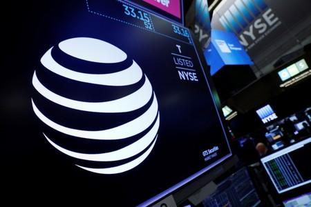 The AT&T logo is seen on a monitor on the floor of the New York Stock Exchange (NYSE)