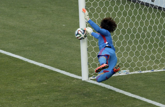 Mexico's goalkeeper Guillermo Ochoa makes a save during the group A World Cup soccer match between Brazil and Mexico at the Arena Castelao in Fortaleza, Brazil, Tuesday, June 17, 2014