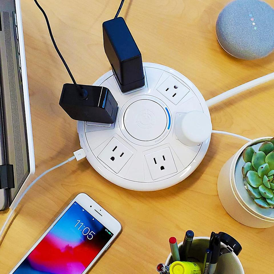 "<p>Protect your computer from unwelcome power surges (and your social life from a phone that dies when you need it most) with a multi-outlet charging station and surge protector. A simple round shape means no puzzling over which order your plugs will fit, and two additional USB ports mean your phone never needs to end up in low power mode.</p> <p><em><strong>Shop Now:</strong> Accell ""Power Air"" Surge Protector and USB Charging Station, $34.81, <a href=""https://www.amazon.com/Accell-Power-Air-Protector-D080B-048F/dp/B0845MYPDK/ref=as_li_ss_tl?ie=UTF8&linkCode=ll1&tag=mslhome21dormstorageideasbcopelandjul20-20&linkId=2c67e7f9cdb9377d36981db5dc97eaa6"" rel=""nofollow noopener"" target=""_blank"" data-ylk=""slk:amazon.com"" class=""link rapid-noclick-resp"">amazon.com</a>.</em></p>"