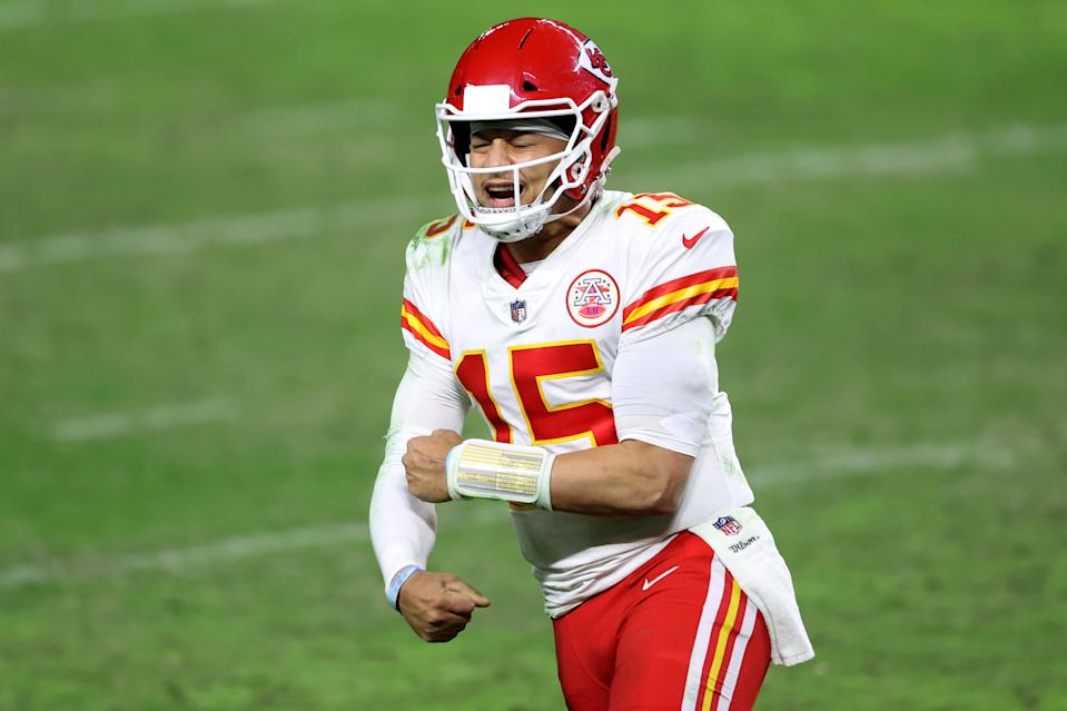 Quarterback Patrick Mahomes #15 reacts after a game winning touchdown pass to tight end Travis Kelce