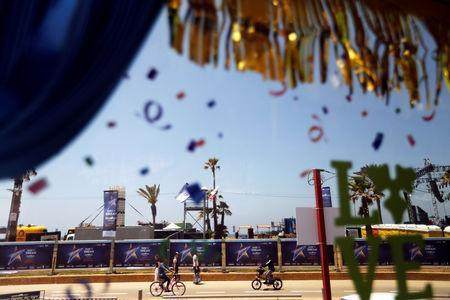 The 2019 Eurovision Song Contest logo is seen on partitions near the Eurovision Village, an area for fans of the contest, as seen through the window of a tourist bus, in Tel Aviv, Israel May 12, 2019. REUTERS/Ronen Zvulun