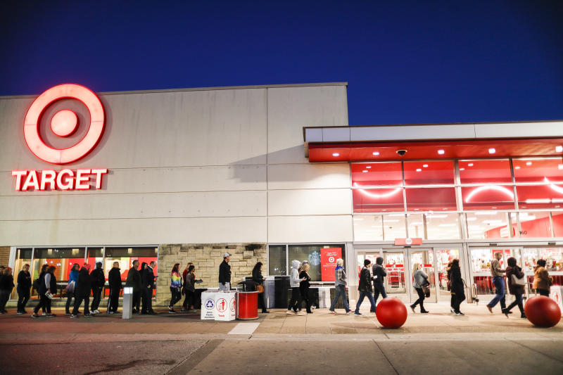 Shoppers wait in queue outside for Black Friday sales at a Target store, Friday, Nov. 23, 2018, in Newport, Ky. (AP Photo/John Minchillo)